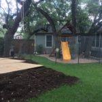 "TREE PROTECTION A 8""-10"" layer of hardwood mulch is spread over the Critical Root Zones of the above Live Oaks.  These trees are protected prior to a skid steer accessing the back yard to dig the hole for a new swimming pool.  We utilized mulch and plywood to disperse the weight of the skid steer over the root zone in order to minimize soil compaction through the root zone.  Fencing was used to cut off access of workers, equipment and materials to the Critical Root Zones of these Live Oaks."